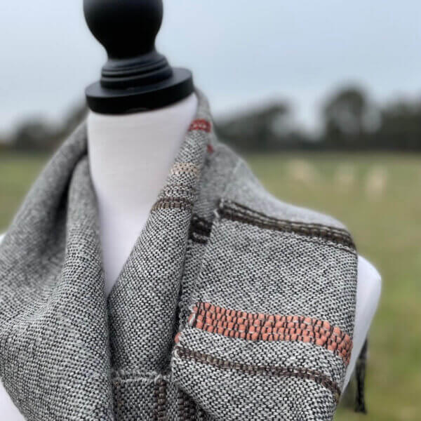 grey scarf with tan detail